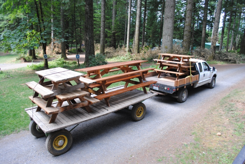 Moving the Picnic tables to storage for the winter.