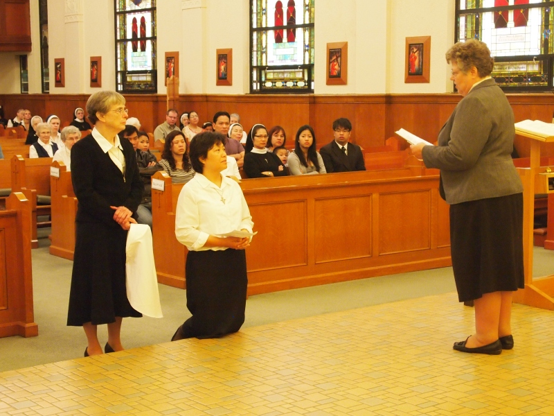 Sister Anna Nguyen receives her white veil, the symbol of a novice in religious life.