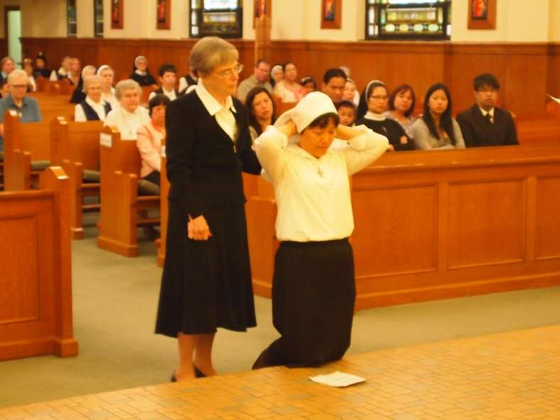 Sister Anna Nguyen adjusts her veil.