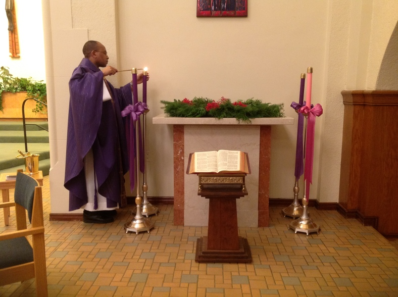 Fr. Peter lights the ADVENT candle at the Convent Chapel of the Sisters of St. Mary of Oregon.