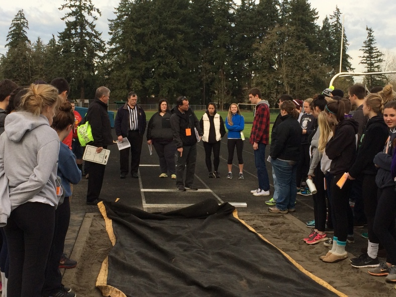 CYO Track and Field officials training assembled at the long jump pit