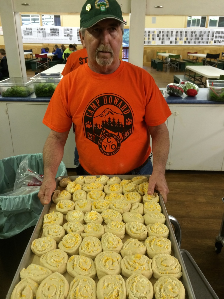 Ron gets the rolls ready to put in the oven