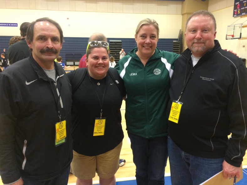 Joe Pisaneschi, Bethany MacNeur, Jenna Bass (CYO Director of Basketball) and George Weivoda are three of the Basketball Commission Members who helped out on Sunday at the championship games.