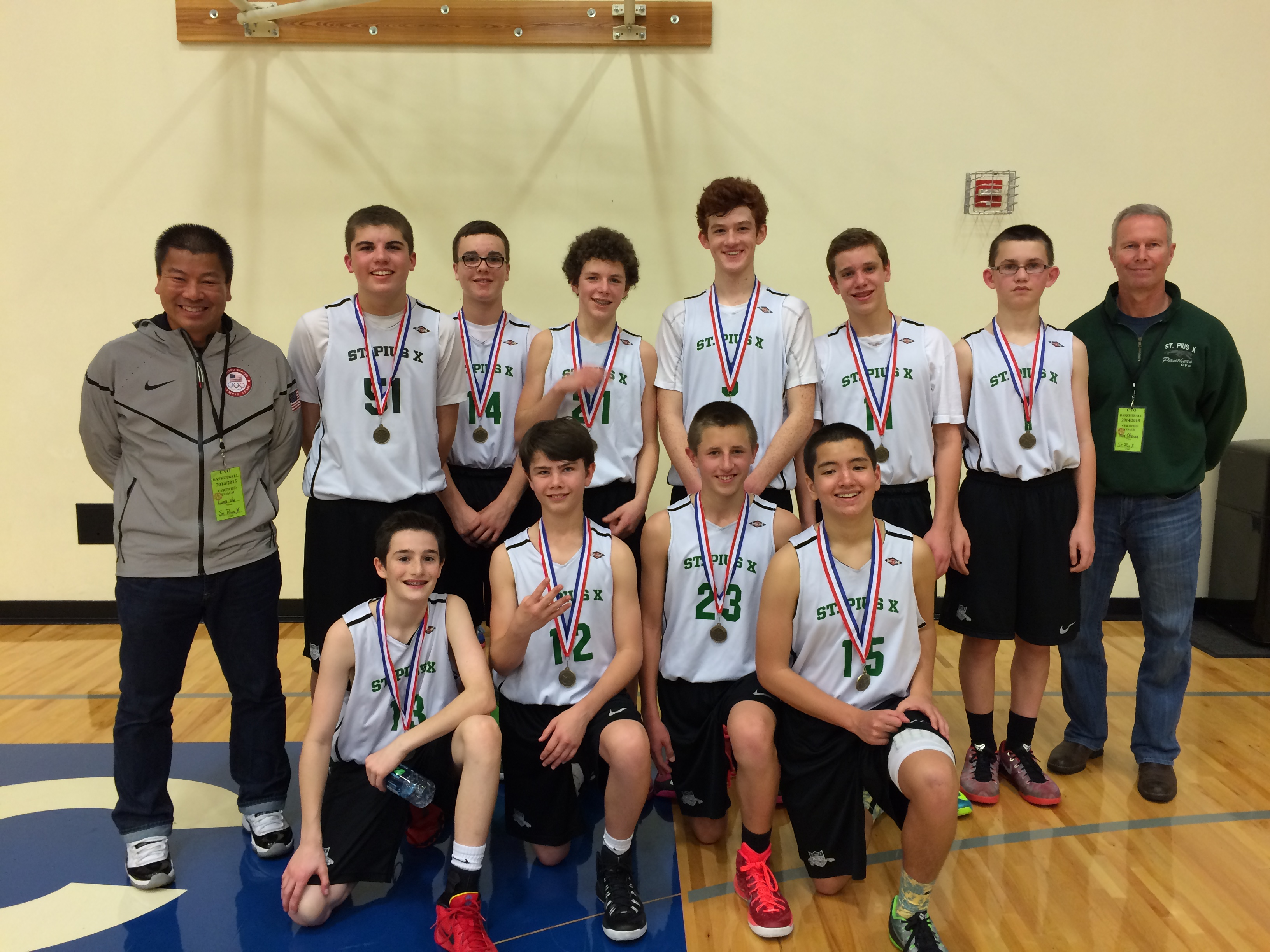 St. PIus X takes third place in the 2015 CYO City Basketball Tournament.