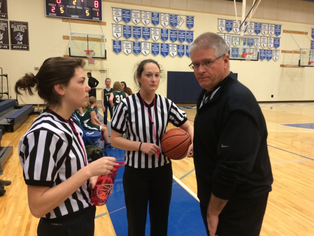 Rick Skayhan visits with two of the officials he has coached up through the program at the CYO Championships 2015