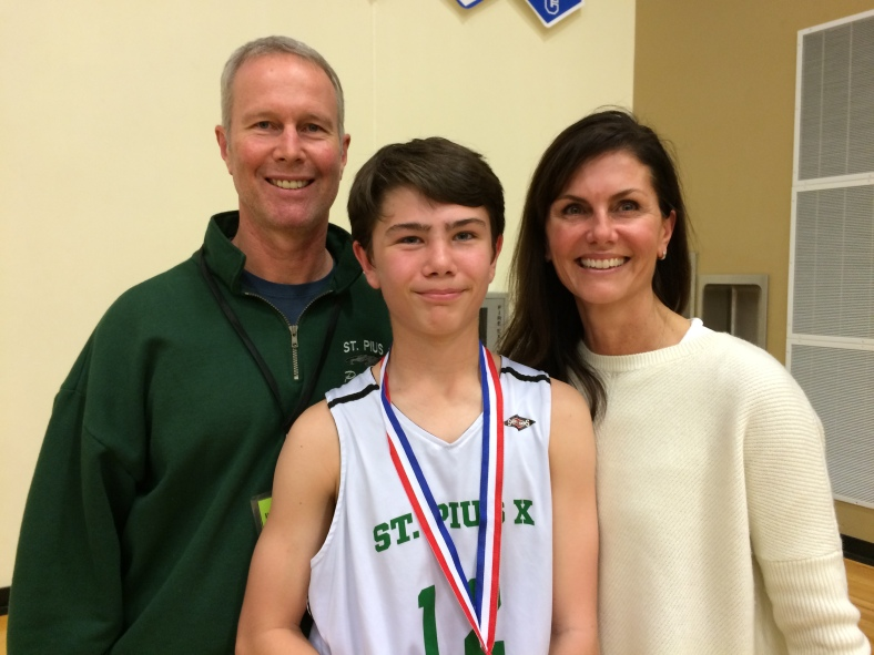 Michael and Joan O'Reilly with their son after the City Championship Game.