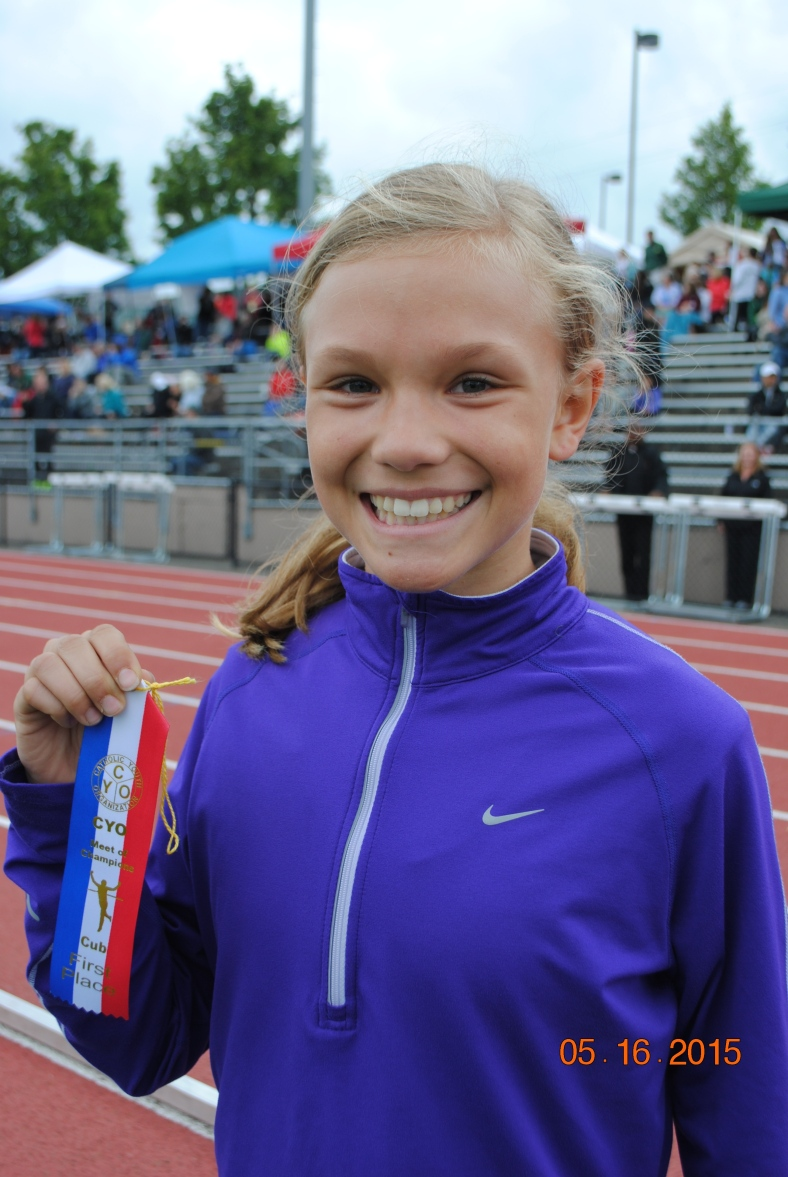 Chloe Foerster from St. Pius X CYO wins the 800 Meter Run for Cub Girls at the CYO Meet of Champions 2015
