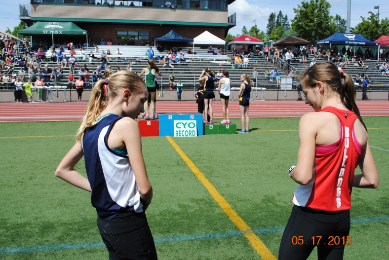 Waiting to be called to the awards stand, Elizabeth Rinck (St. Matthew) and Makenna Schumacher (St. Thomas More) ponder the moment