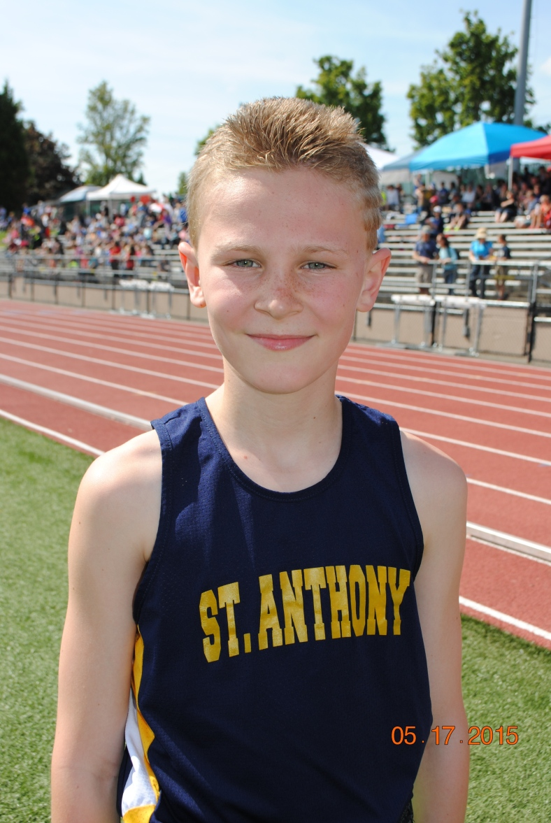 Jeffery Rogers (St. Anthony) wins the Cub Boys division of the 1500 Meter run at the CYO Meet of Champions 2015