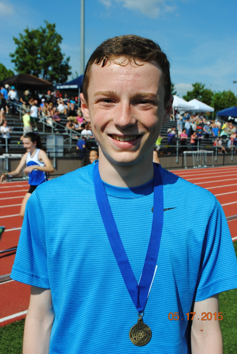 Ethan Reese from St. Pius X CYO Club takes first place in the 1500 Meter run at the CYO Meet of Champions Sunday May 17, 2015 at Jesuit High School.