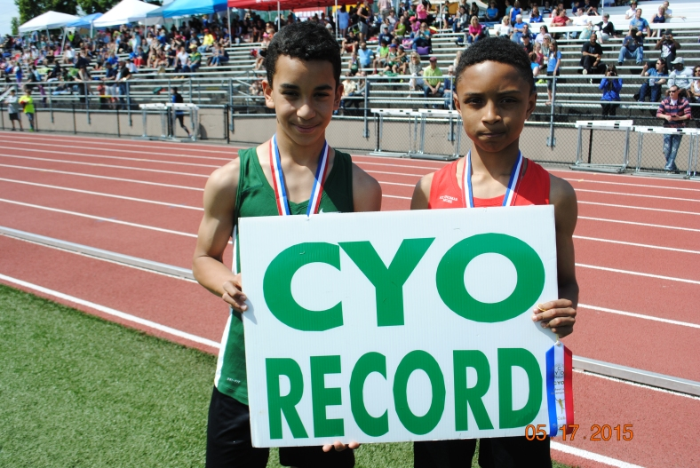 Denzel Pinto and Nathan Mouzong break the CYO Cub Boys Record for the 400 Meter Dash.