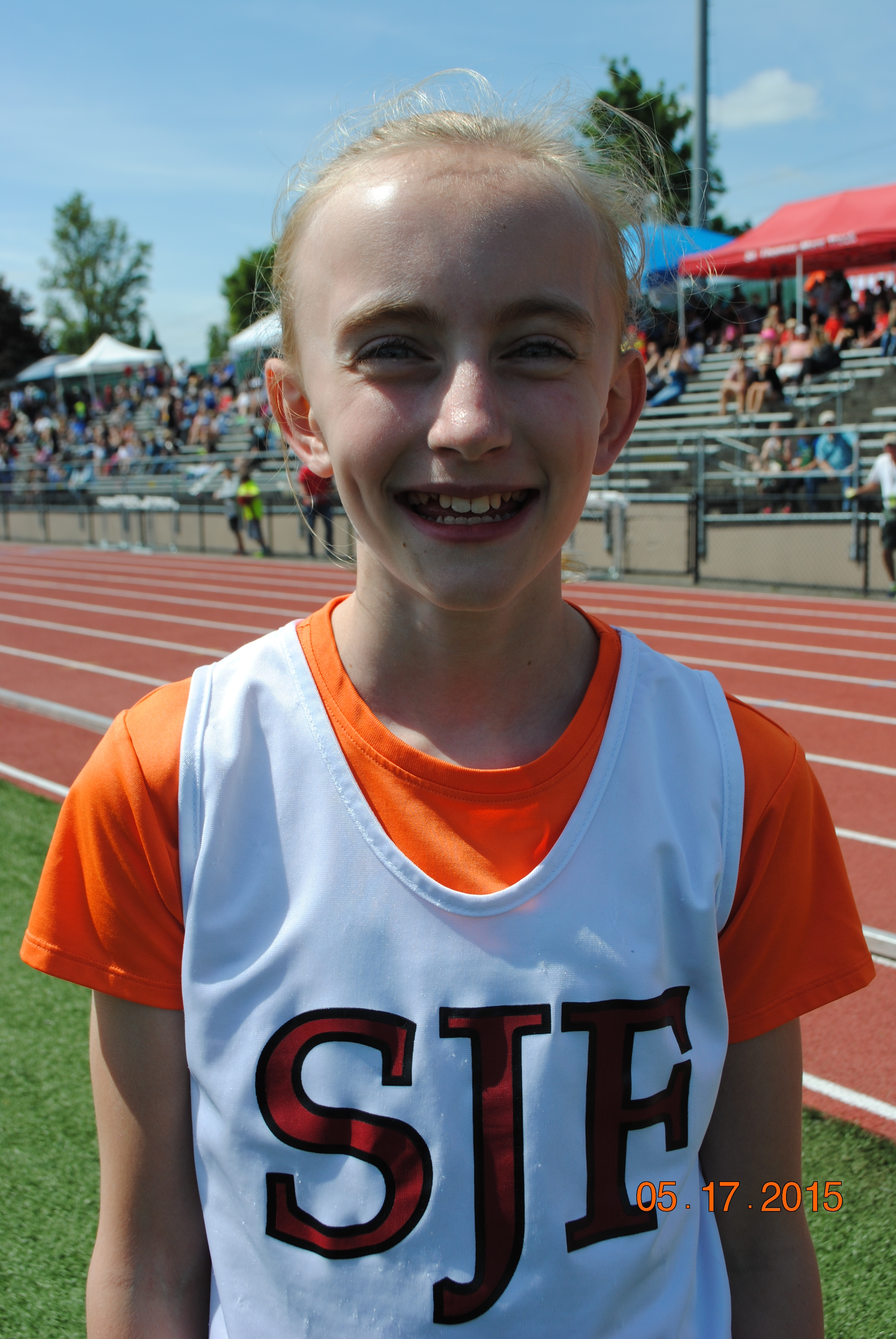 Molly Grant from St. John Fisher School wins the 400 Meter Relay at the CYO Meet of Champions May 17, 2015