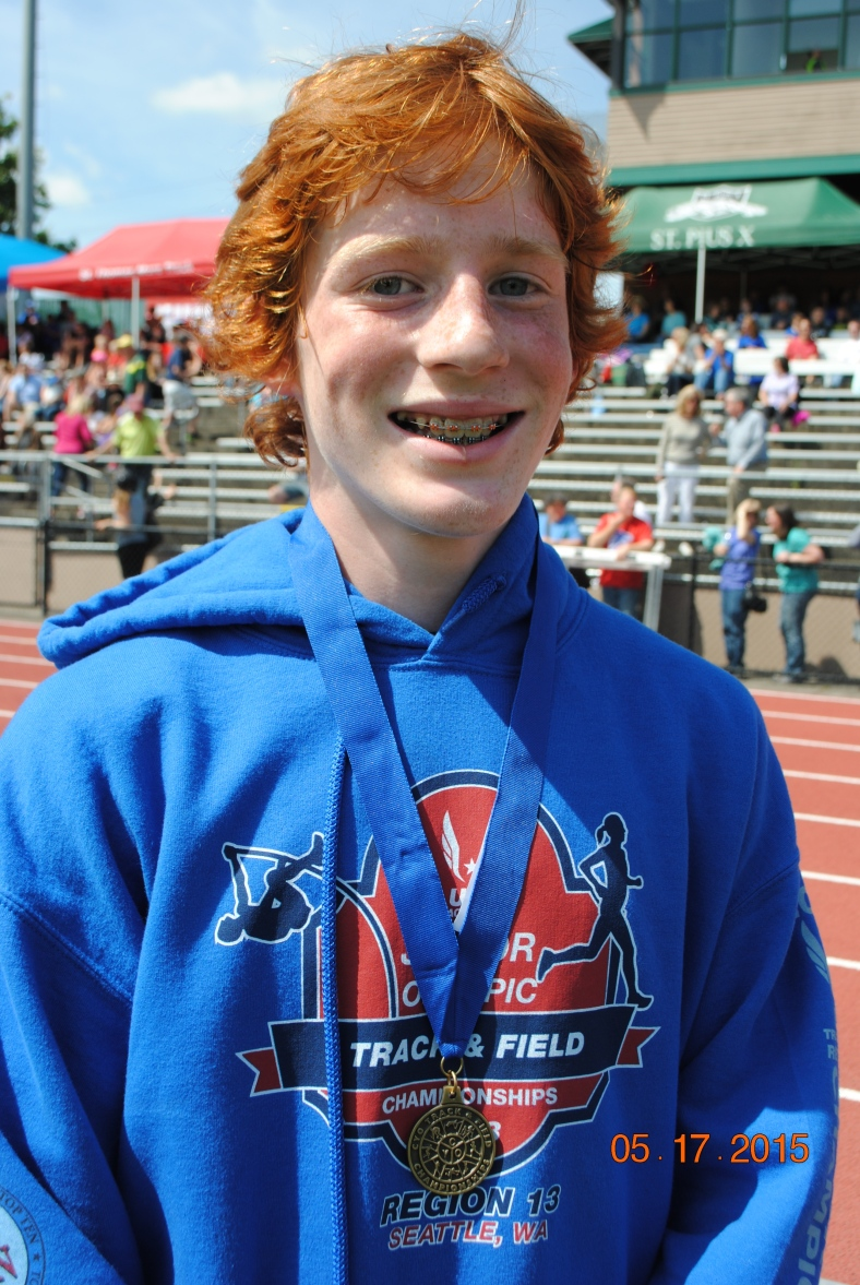 Blake Deringer wins the Cadet Boys 400 Meter Dash at the 2015 CYO Meet of Champions