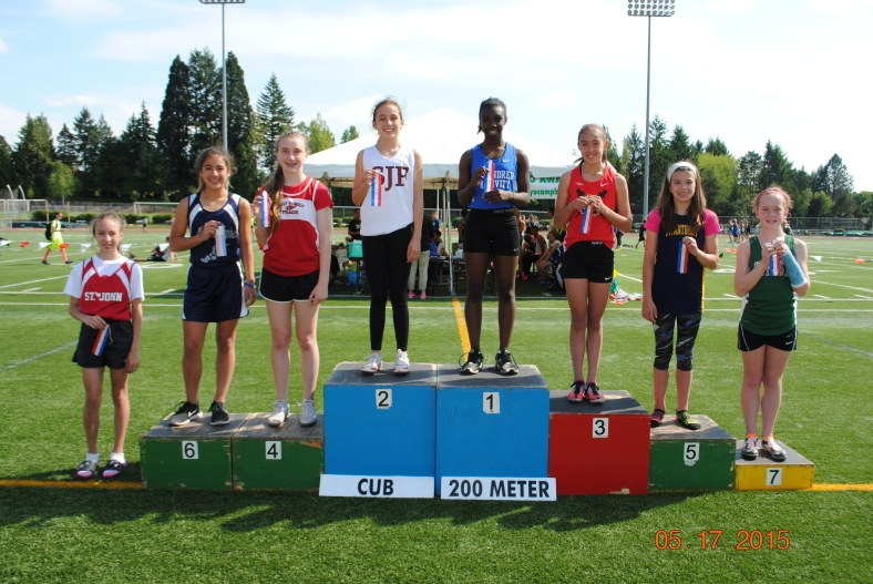 Winners in the 200 meter dash for Cub Girls in the 2015 CYO Meet of Champions