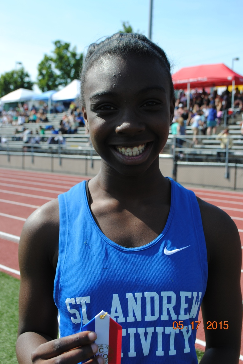 Keziah Hollands wins the 200 meter dash for Cub Girls in the 2015 CYO Meet of Champions