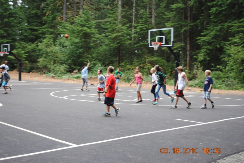 Camp Howard campers enjoying the basketball courts.