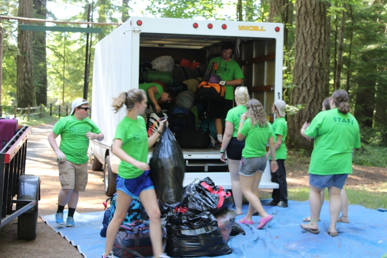 Luggage Crew unloads the luggage before the busses arrive with campers