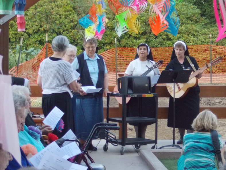 Sr. Josephine, Sr. Charlene, Sr. Juanita and Sr. Adele Marie lead prayer and song as the patio and bocce court are dedicated.