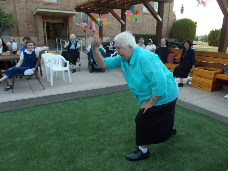 "Sister Ina Marie takes her turn at trying to get her bocce ball closest to the ""Jack"""