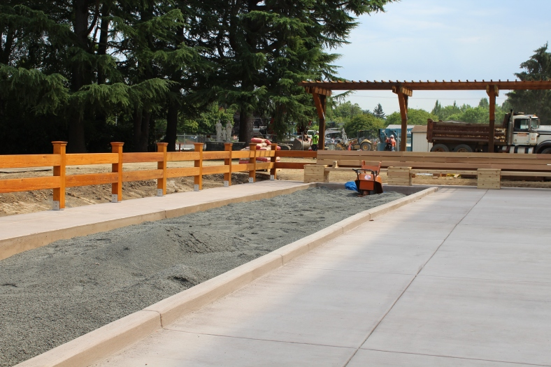 Bocce court and patio begins to take shape.
